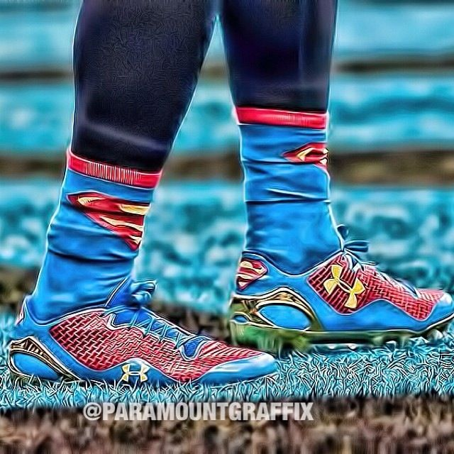 Cam Newton's superman socks and Under Armor cleats