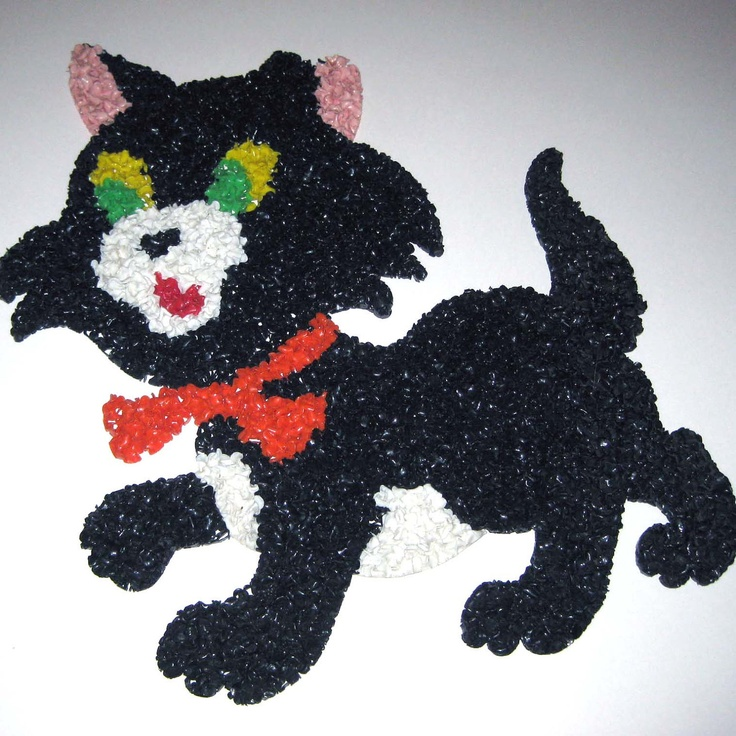 Vintage Black Cat Halloween Melted Plastic Popcorn Decoration. $9.95, via Etsy.