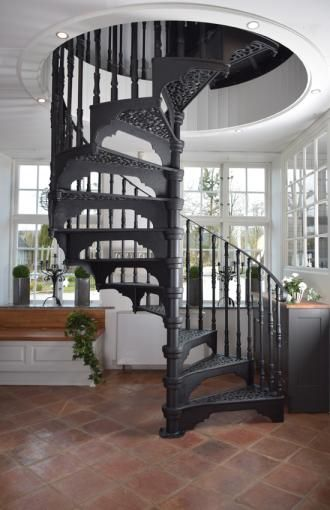 Attic to library conversion: Spiral cast iron staircase. Takes very little room to install.