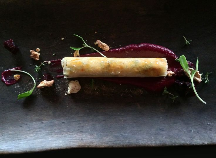 Baked fresh ricotta cheese wrapped in phyllo pastry infused with honey and thyme with beetroot puree.
