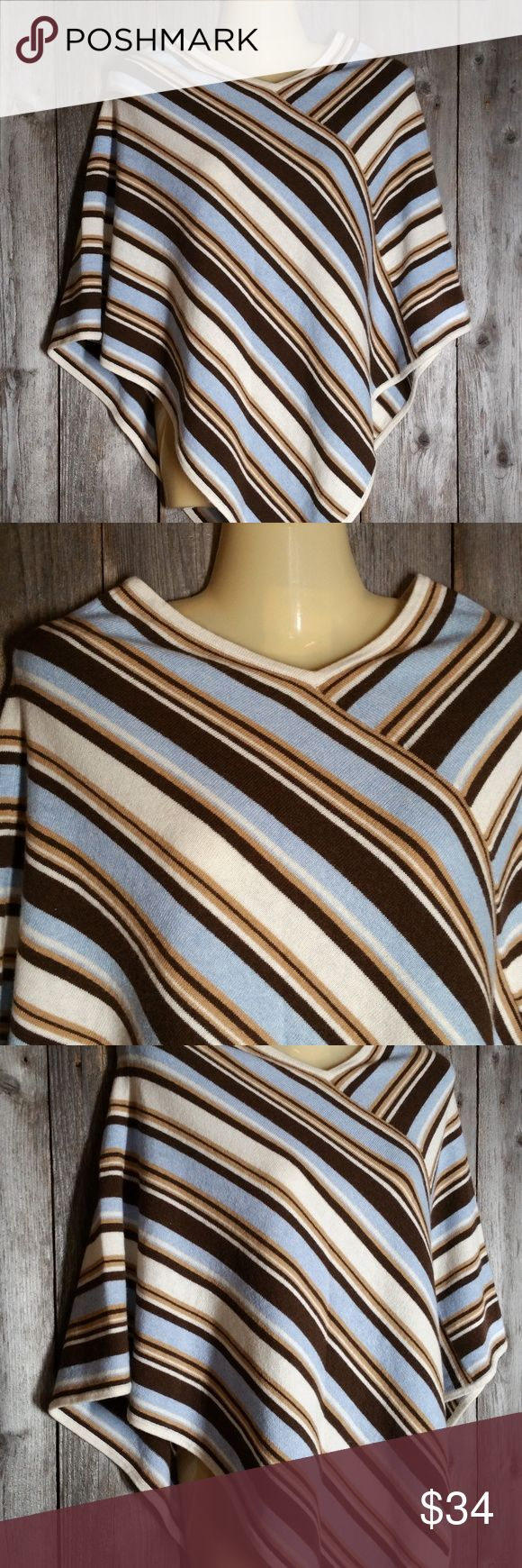 Isadora Story Poncho Sweater Cashmere Blend Isadora Story Poncho Sweater Womens Cashmere Wool Blend Multicolor Striped Gently used One size Merino wool, viscose, nylon & cashmere blend Dry Clean Approx length from top of shoulder 31 Isadora Story Sweaters Shrugs & Ponchos