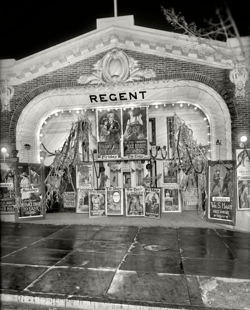 """October 1920. Washington, D.C. """"Lust's Regent."""" Theater impresario Sidney Lust's 18th Street cinema decorated for Halloween with an array of eye-catching movie posters."""