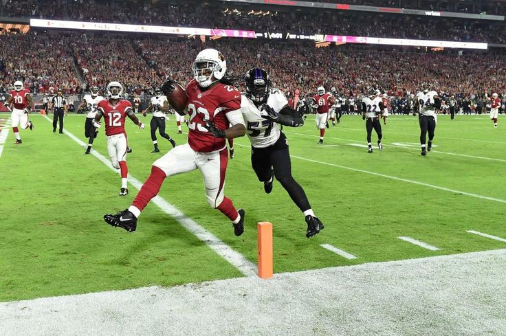 Running back Chris Johnson of the Arizona Cardinals runs in a 26 yard touchdown against linebacker C.J. Mosleyof the Baltimore Ravens in the first quarter of the NFL game at University of Phoenix Stadium on Oct. 26, 2015 in Glendale, Ariz.