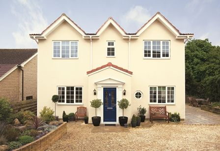 Give your home a sophisticated look by using Weathershield Classic Cream on the walls and Exterior Gloss paint in Oxford Blue on the front door.