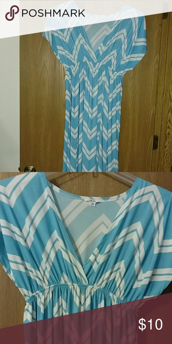 Blue and white maxi dress Blue and white maxi dress. Only worn once. Size is XL, but the material is very stretchy. Dresses Maxi