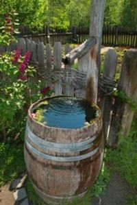 Garden Rain Barrels - want this...so cool for the backyard....