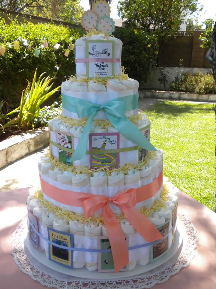 Storybook Baby Shower - Diaper Cake with Mom-to-be's favorite books - printed and matted with colored cardstock