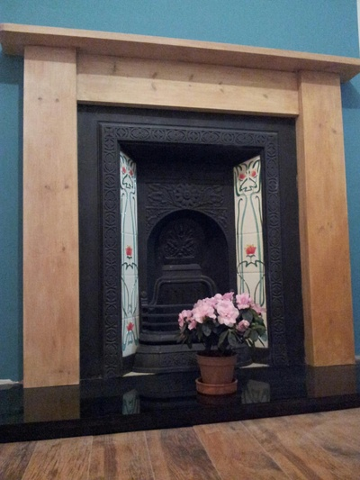 Our renovated dining room complete with fireplace and hand made surround.