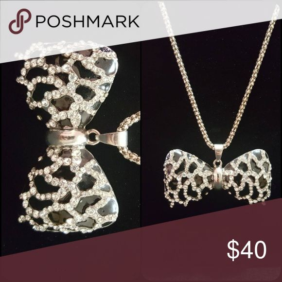 Super cute bow necklace NEW shimmery long bow necklace.  You'll love how it adds a youthful touch to any outfit Jewelry Necklaces