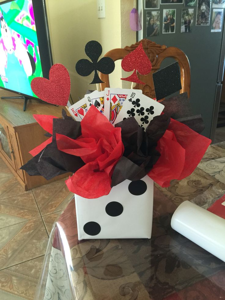 Casino themed birthday party centerpiece                                                                                                                                                      More