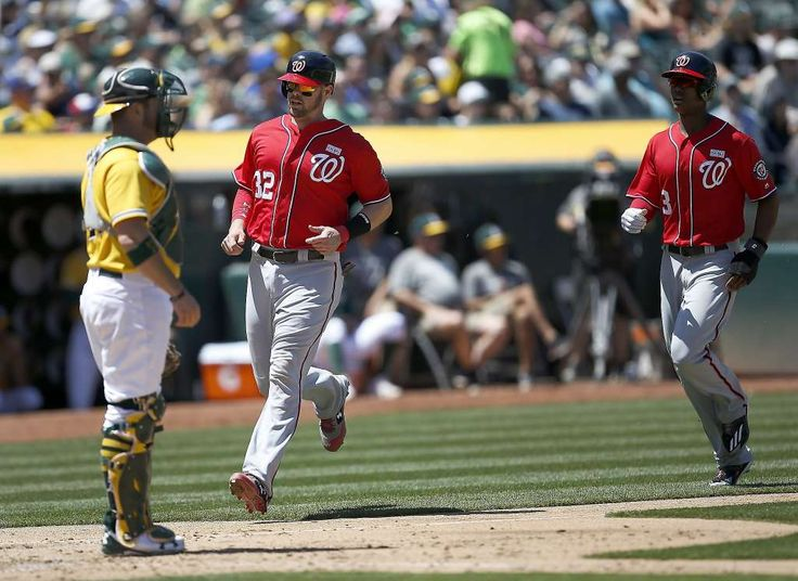The Nationals' Matt Wieters (32) and Michael Taylor score in front of A's catcher Stephen Vogt on a triple by Trea Turner during the sixth inning, giving Washington a 2-1 lead. Photo: Tony Avelar, Associated Press
