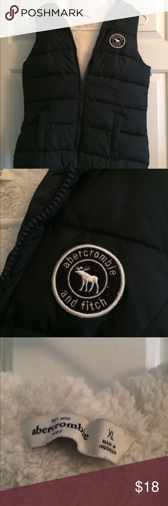 Abercrombie girls navy hooded puffer vest Size xl Abercrombie girls navy faux fur lined puffer vest with hood. Excellent condition! Abercrombie & Fitch Jackets & Coats Vests