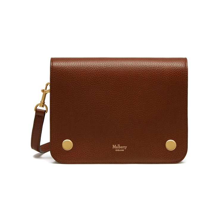 Shop the Clifton in Oak Natural Grain Leather at Mulberry.com. The Clifton is compact, understated shoulder bag that cleverly camouflages an organiser's paradise underneath its neat exterior. Internal compartments provide ample room for essentials, and the leather strap can be adjusted and styled in different ways. Signature press studs and a subtle Mulberry logo are the final embellishments.