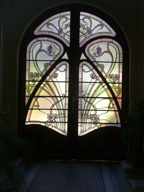 Beautiful stained glass inserts in this old door