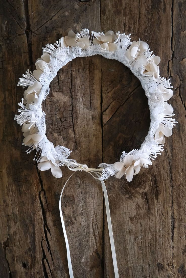 Maia Wreath A little boho wreath for a gorgeous little flower girl. Individual silk hydrangea petals dance around pearl white stamen bunches and gathered lace trim. Finished with a silk ribbon bow at the centre back to hang down the back of the neck.