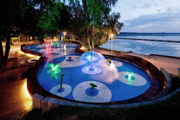 This splash pad that turns into an LED water show at night. | 12 Ridiculously Cool Playgrounds That'll Make You Want To Be A Kid Again
