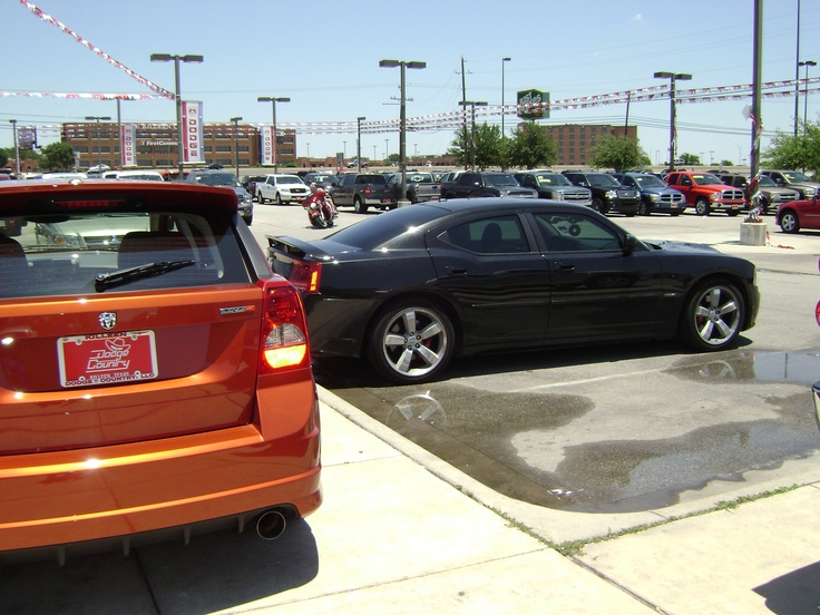 Caliber SRT4 that was for sale at Dodge Country in Killeen, TX and my 2006 Charger SRT8 that I bought from that same dealership.  First SRT8 sold in Bell County, TX