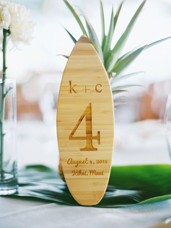 Surf board inspired wooden table numbers: http://www.stylemepretty.com/destination-weddings/hawaii-weddings/2016/01/09/elegant-colorful-tropical-beachside-wedding/ | Photography: Wendy Laurel - http://www.wendylaurel.com/