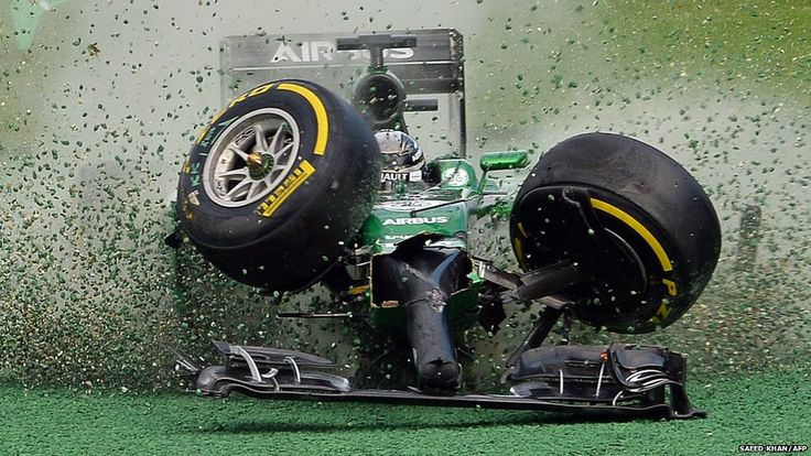 Caterham-Renault driver Kamui Kobayashi of Japan veers off the track during an accident at the start of the Formula 1 Australian Grand Prix ...