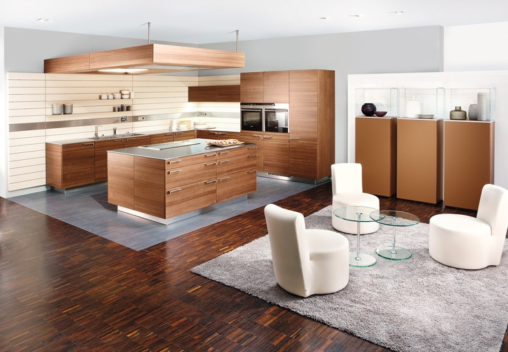 +ARTESIO Kitchen by Poggenpohl, in walnut finish - The integrated approach to kitchen and space embraces floor, walls, and even the ceiling. With it's innovative ceiling elements, the 'function arch' facilitates power management and provides accommodation for audio system, ventilation extractor, or indirect LED lighting.