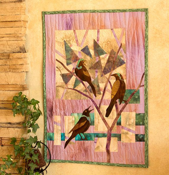 Using ice dyed and hand painted fabric for the background, this quilt is constructed by using raw edge applique with hand painted fabrics,