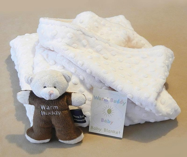 Wrap your baby in total warmth and comfort with Warm Buddy ultra cozy and cute baby blanket. The face of the blanket has soft dots and the inner side is plain but super soft. Accompanied with a mini plush Teddy perfectly sized for the tiny hands.    This product is not to be heated!