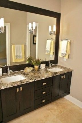 Mega Greige paint, espresso cabinets, framed mirror. Love this for our next remodeling of our on suite bathroom! This is why I pin...I'll use them someday!