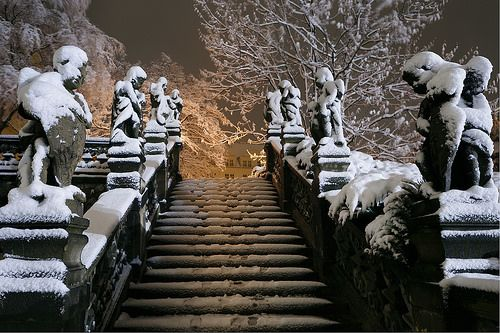 Prague during winter - statues under snow magical hour