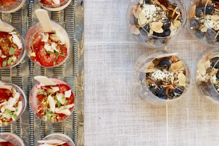 HealthyBYTe launch by Bright Young Things  Right side : Ancient grains bircher with chia seeds, blueberries and almonds Left Side : Schultz's yogurt, fresh strawberry, nut and coconut crumble.