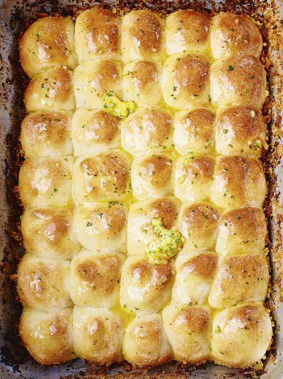 This garlic bread recipe from Jamie Oliver is perfect for any occasion; find a combination of soft, spongy and crunchy textures with a pungent garlic butter.