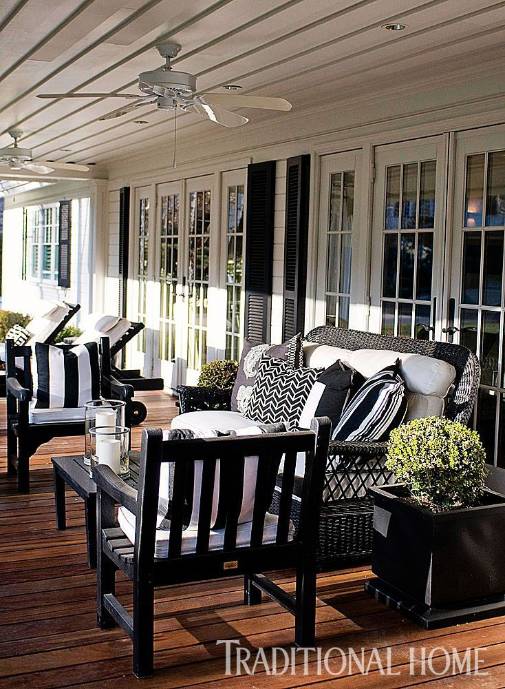 Casual, Family-Friendly California Home   Traditional Home: Designer Kriste Michelini painted teak furniture black and paired it with black-and-white pillows and black shutters on the house for a classic appeal. The wicker loveseat is from Lane Venture. #teakfurnitureforsummer