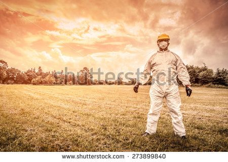 Spooky chemist on a countryside field
