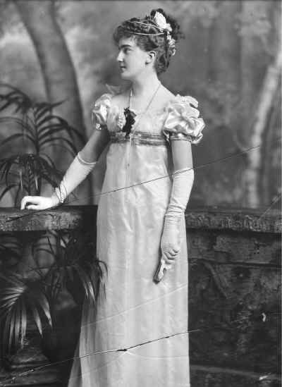 Maud (Frederica Elizabeth), Viscountess Milton, later Countess Fitzwilliam (1877-1967), née Dundas, the second daughter of the 1st Marquis of Zetland. She models an early 1800s costume, which she wore for the Devonshire (England) House Masquerade Ball, 2 July 1897.