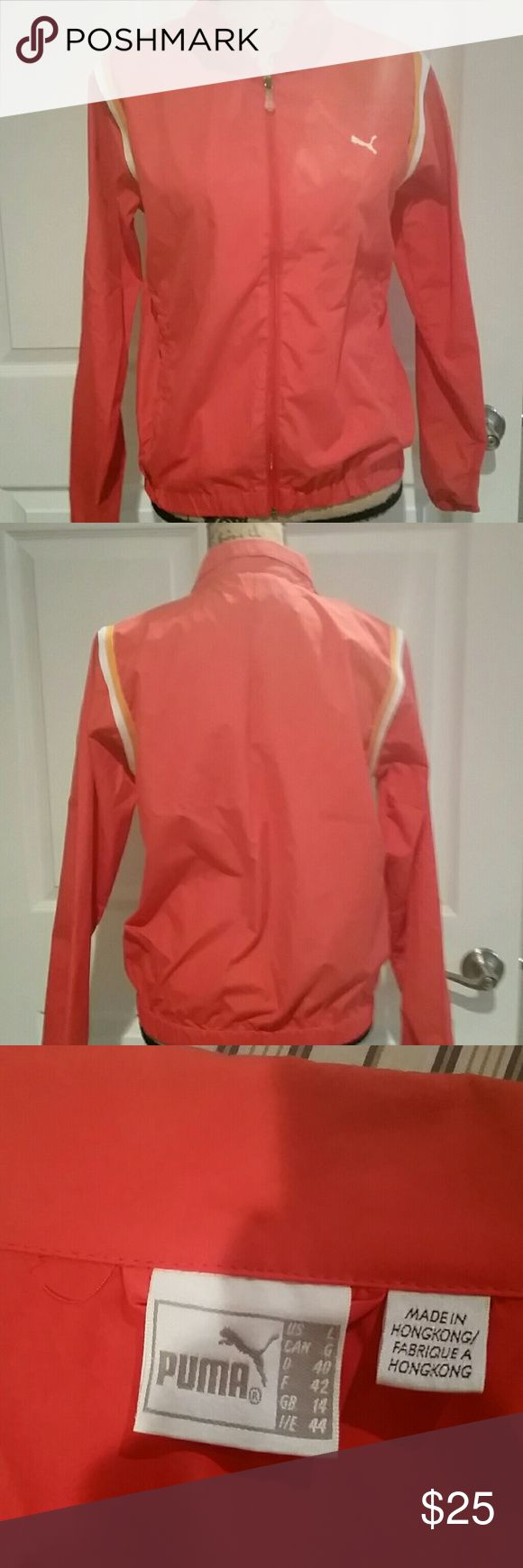 Puma windbreaker warmup jacket Like new puma jacket with pockets. Don't think this was ever actually worn. Bright orange dark coral color Puma Jackets & Coats