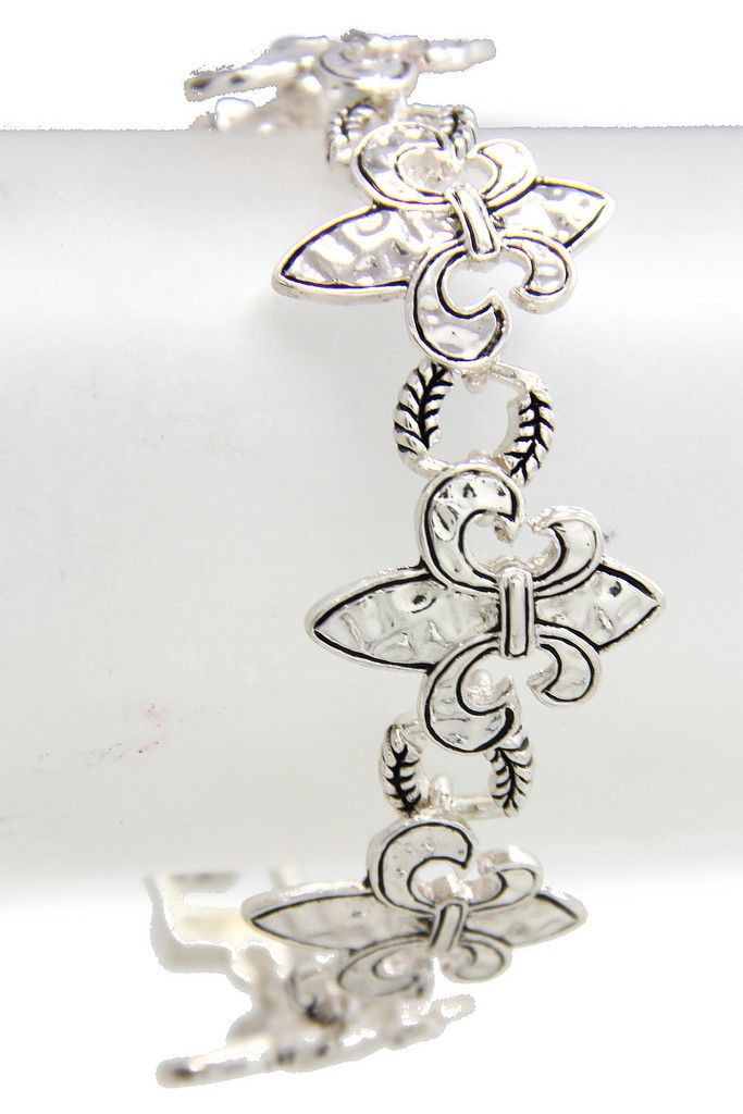 Silver tone link style Fleur de Lis bracelet with magnetic closure.