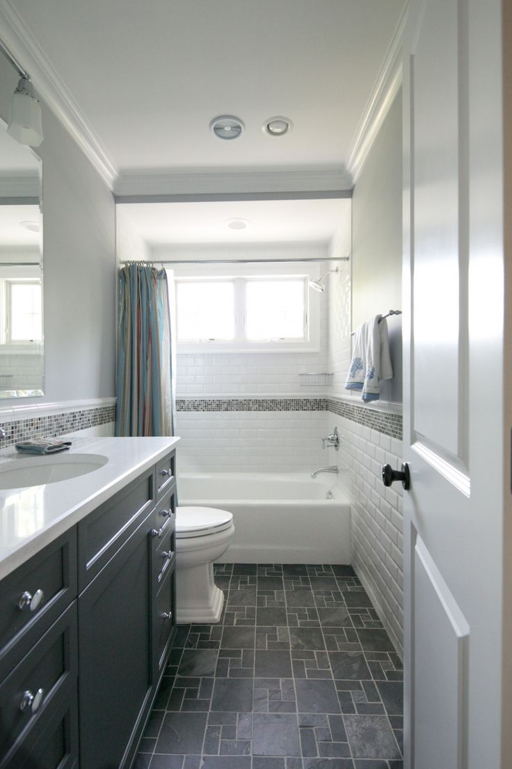 Tiny hall bath, subway tile, dark floors, dark vanity.  Classic and dramatic.