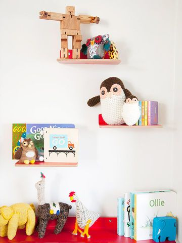These little red shelves hold board books and knickknacks in Oliver's room. ($10-$20)