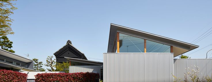 ARII IRIE architects crowns japanese house with elevated roofs in hamamatsu
