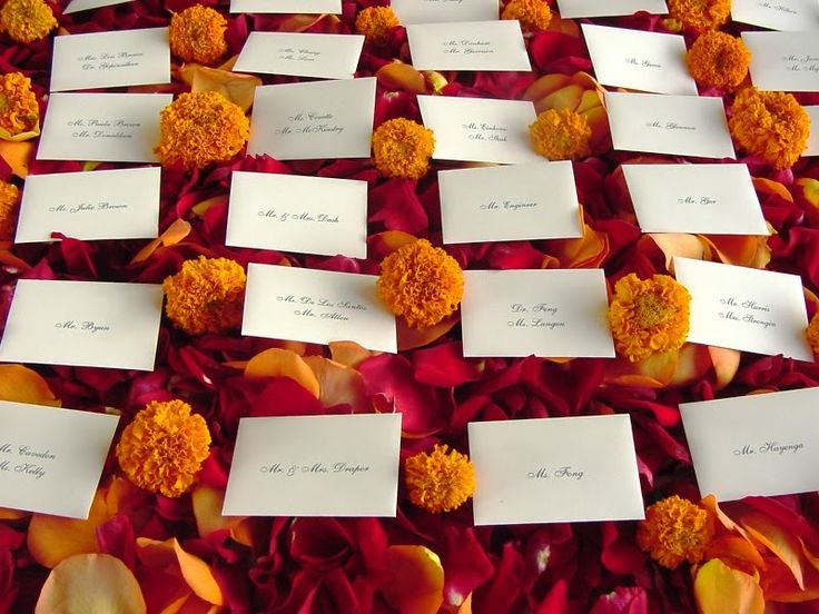 Marigold-wedding-inspiration-escort-cards-with-rose-petals.full