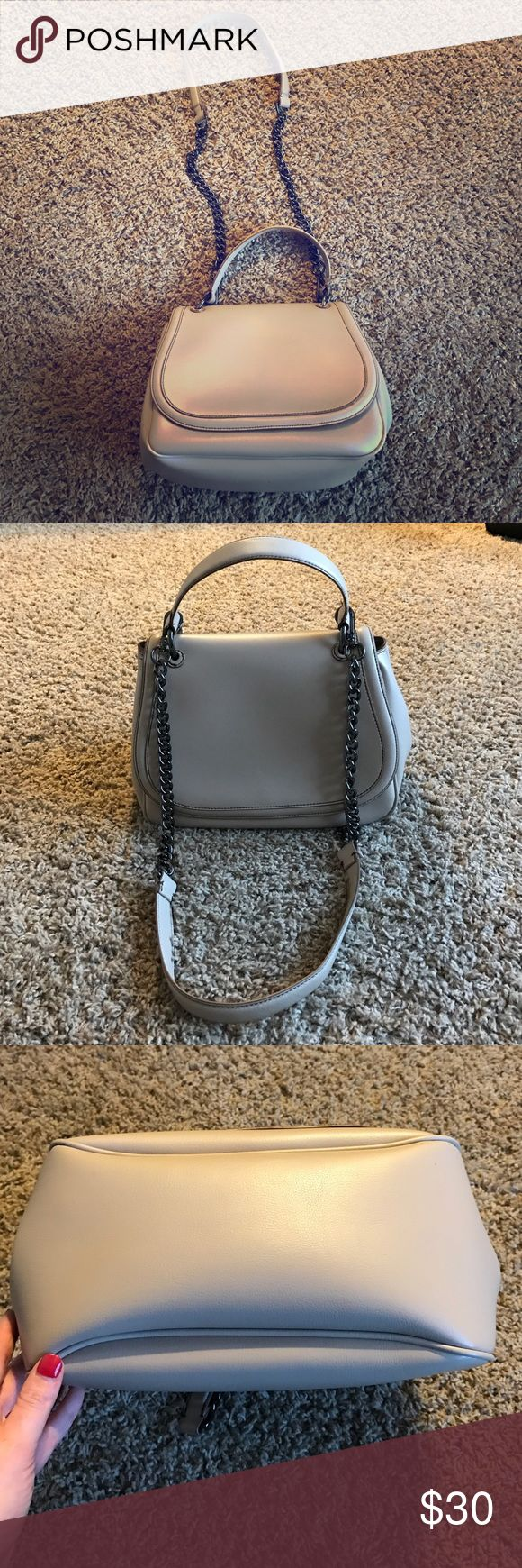 Gorgeous Zara purse Measurements first, ladies: 20 inch chain strap, 12 inches wide, 10 inches long. Secure clasp, inner zip pocket for things you want to hide, two small pockets and a larger storage pocket for stuff like tampons or your large collection of pens, who knows🤷🏻‍♀️😉! It's in PERFECT condition! No flaws! Just purchased from Zara and then I got a new bag for xmas! Zara Bags