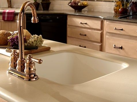 Beautiful Copper Accents In This Kitchen And An Integrated Sink Too Solid Surface Means