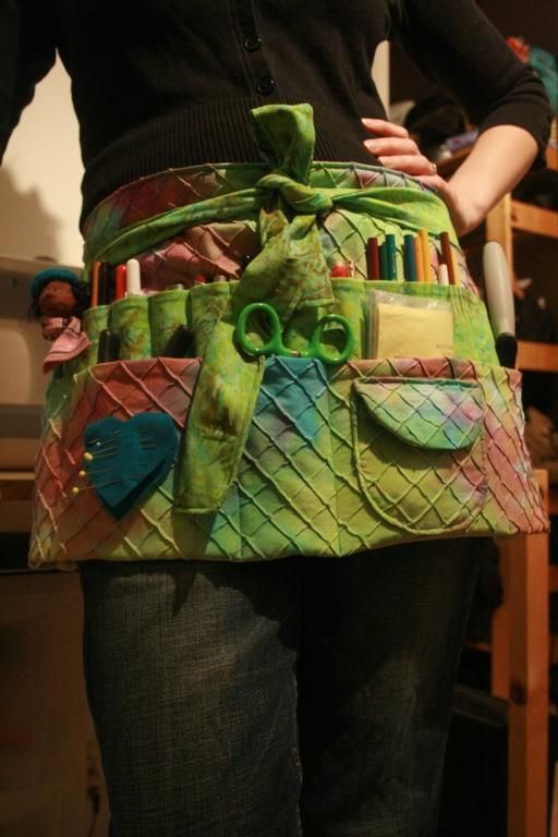 Woman Modeling Green Textured Apron with Lots of Pockets - very cute- good for gardening, too!