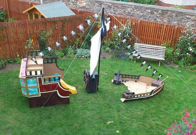 Cardboard build pirate ship in garden for pirate party.