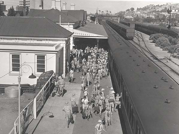 School children preparing for the arrival of Queen Elizabeth 11 at Wagga Wagga Railway Precinct- view of track side, 1954.