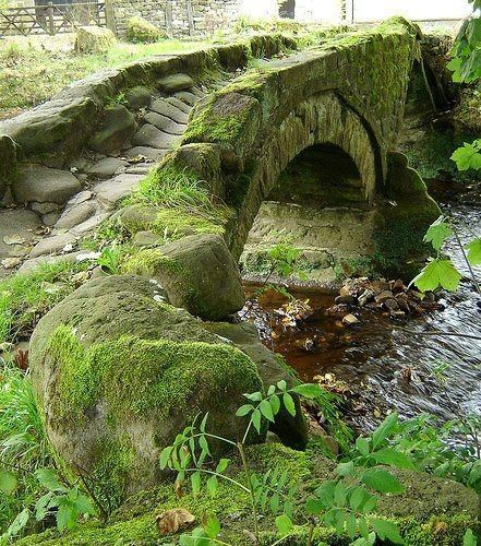 Packhorse bridge, 800 years old, crossing Wycoller Beck in Lancashire, England. [or The Highlands, Scotland]
