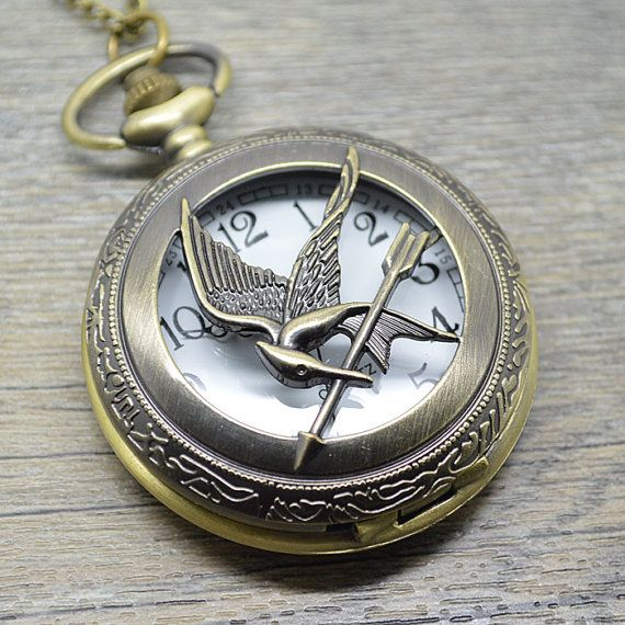 Image result for mockingjay timepiece
