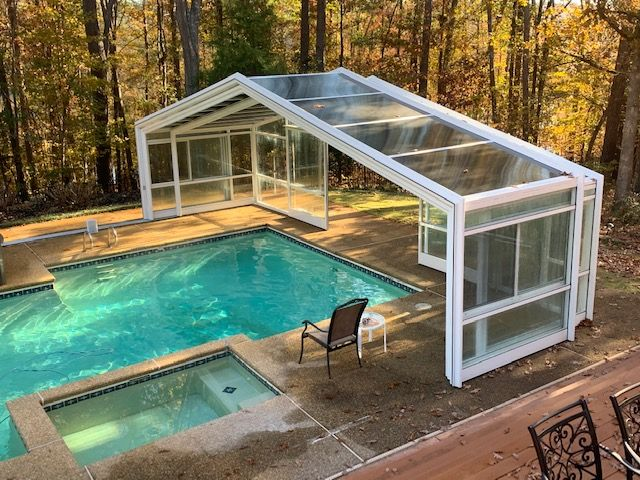 Georgia Pool Enclosure Manufactured By Roll A Cover Indoor Outdoor Pool Residential Pool Pool Houses