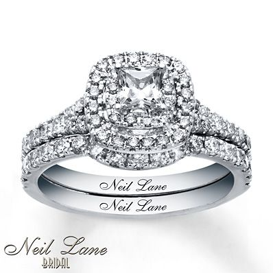 This bridal set for her from the Neil Lane Bridal® collection includes an engagement ring that showcases a thrilling princess-cut diamond framed in two rows of round diamonds. Additional round diamonds sparkle along the band of the engagement ring and the matching contoured wedding band. The bridal set has a total diamond weight of 1 1/3 carats and is styled in 14K white gold. Diamond Total Carat Weight may range from 1.29 - 1.36 carats.