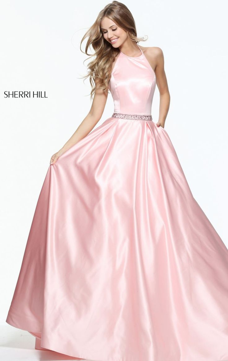 Walk with confidence in Sherri Hill 51036. Halter neckline with mid-open back flatters your supple skin.