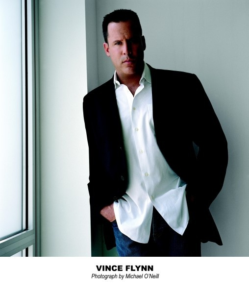 Vince Flynn! Great author & he's hot.